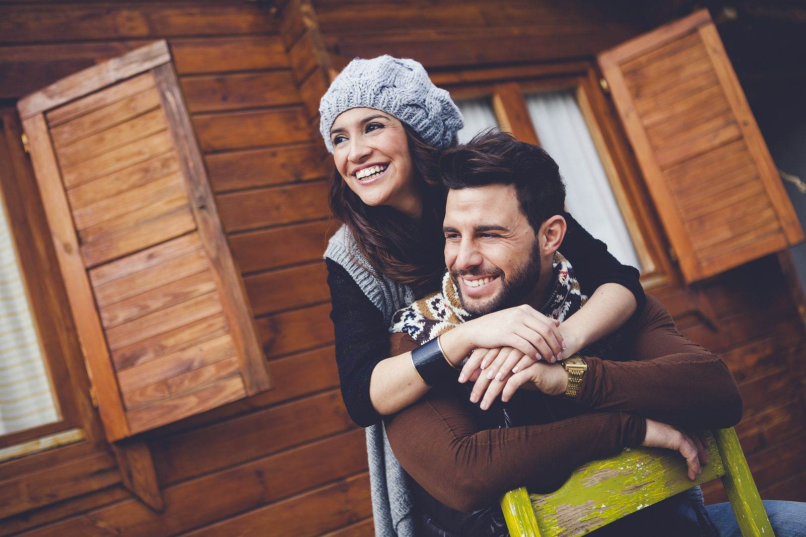 young cheerful couple in a cabin